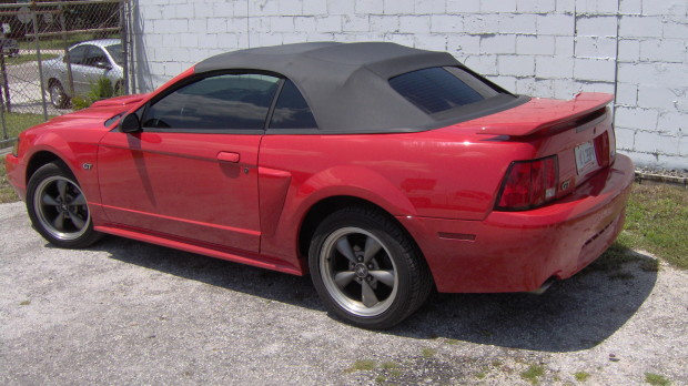 Red Mustang replaced black convertible top